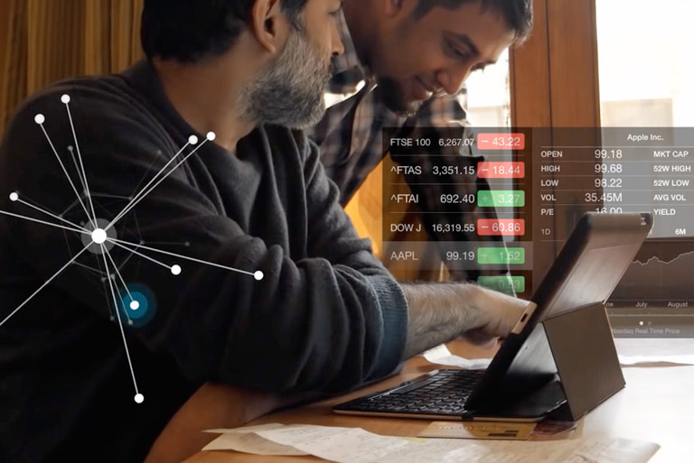 Photo: Two individuals looking at computer together, overlaid with data visualization screenshots
